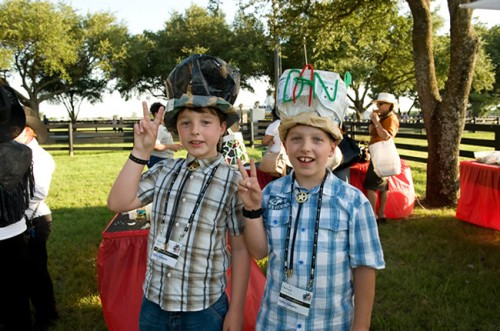 two boys showing off their crafty party hats at birthday in dallas tx