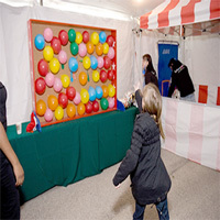 8. Balloon Pop Wall with Darts